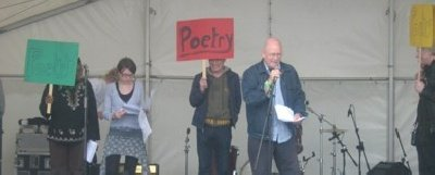 Dave Morgan backed by the massed poets at the Darnhill Festival, Rochdale July 2007